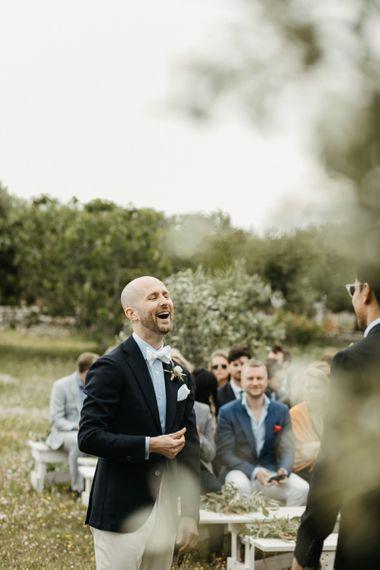 Groom in blue wedding jacket and shirt