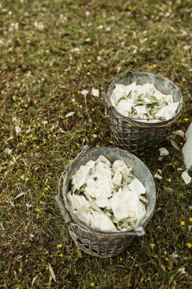 White petals in confetti basket