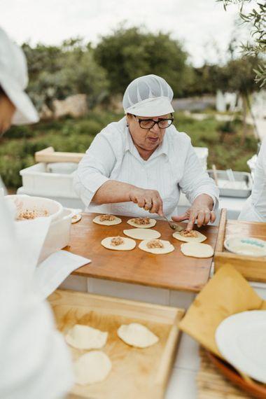 Chef prepares wedding food at Masseria Moroseta