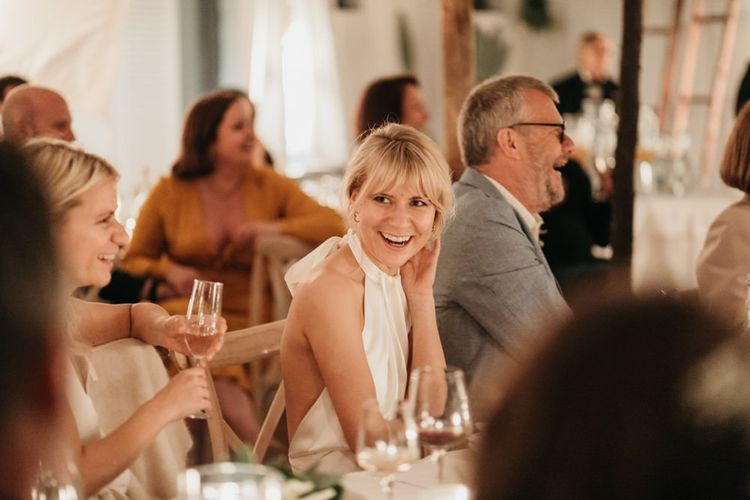 Bride enjoys wedding speeches
