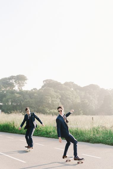 Groom In Navy Suit With Maroon Waistcoat From Moss Bros. // Image By Emma Pilkington