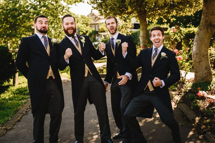 Groomsmen In Tails With Mustard Yellow Waistcoats From Moss Bros. // Image By Andy Gaines Photography