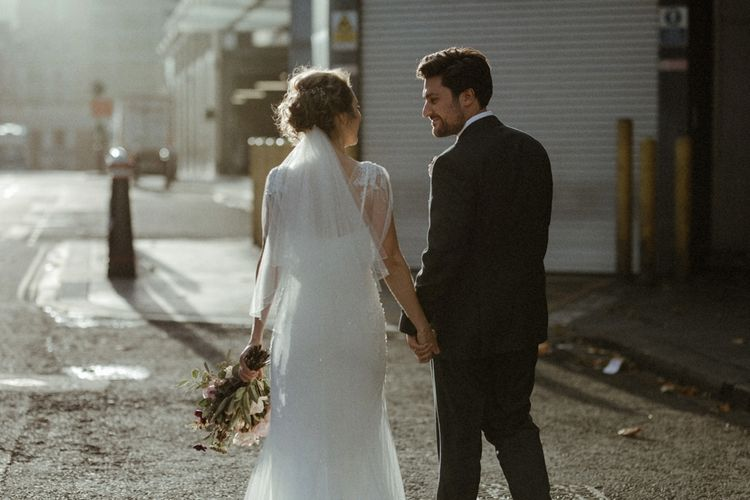 Groom In Moss Bros. Suit // Image By Olivia & Dan Photography