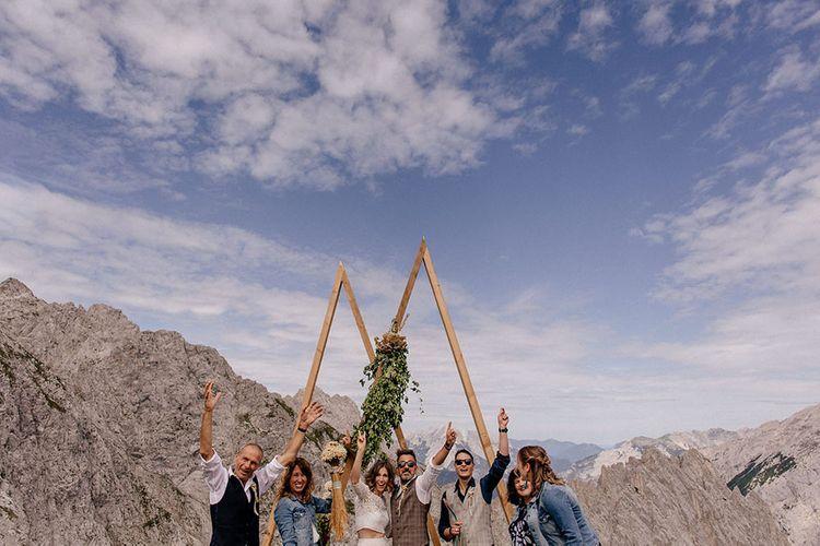 Intimate mountain wedding party portrait