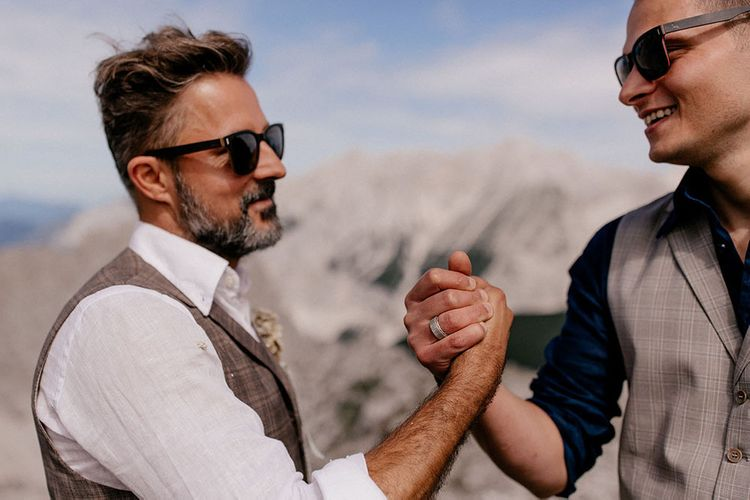 Groom and groomsmen shaking hands