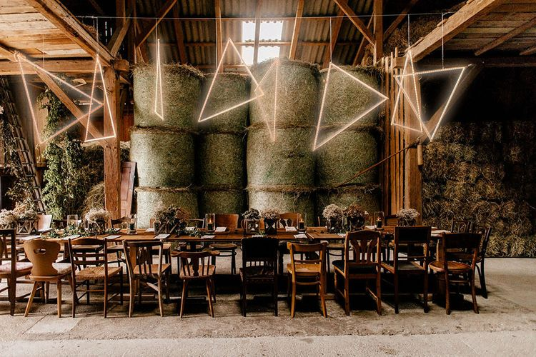 Intimate tablescape decor with hanging geometric light installations
