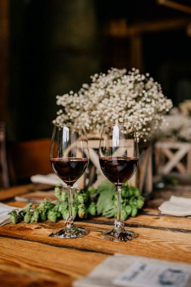 Glass of red wine at mountain wedding reception