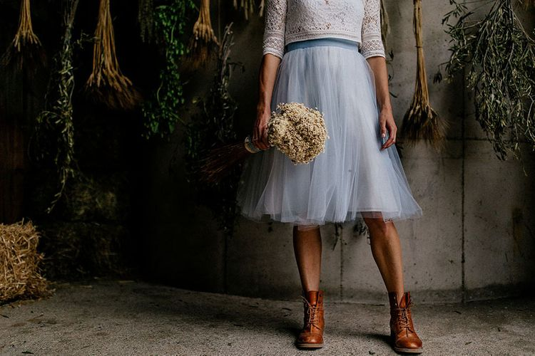 Bride in blue tulle wedding skirt and bridal boots for mountain wedding