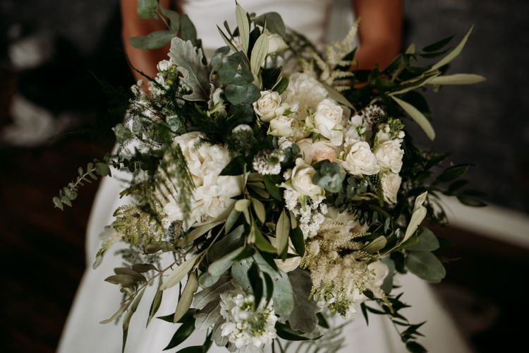 Foliage and flower bouquet for wedding with cupcake wedding cake