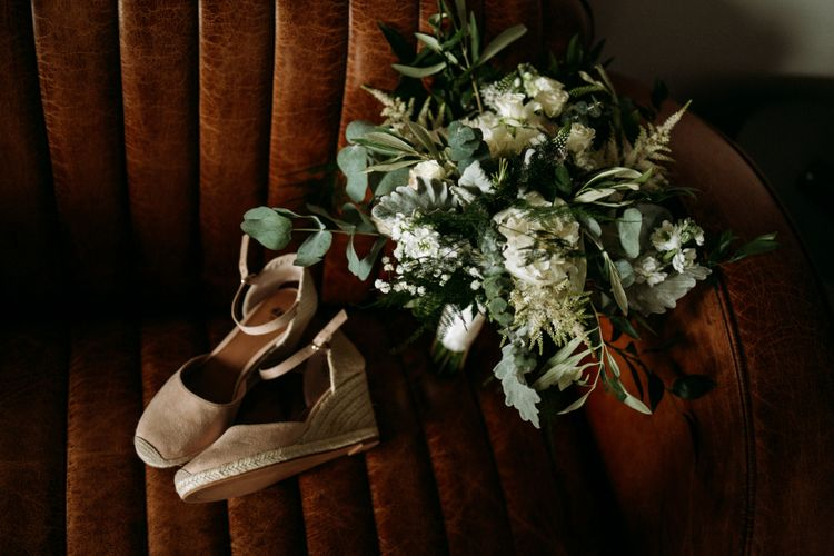 Foliage bouquet and bridal wedges for industrial wedding with cupcake wedding cake