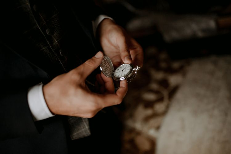 Pocket watch for groom at wedding with cupcake wedding cake