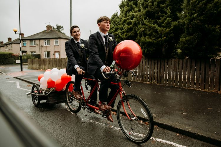 Groom arrives on tandem bike