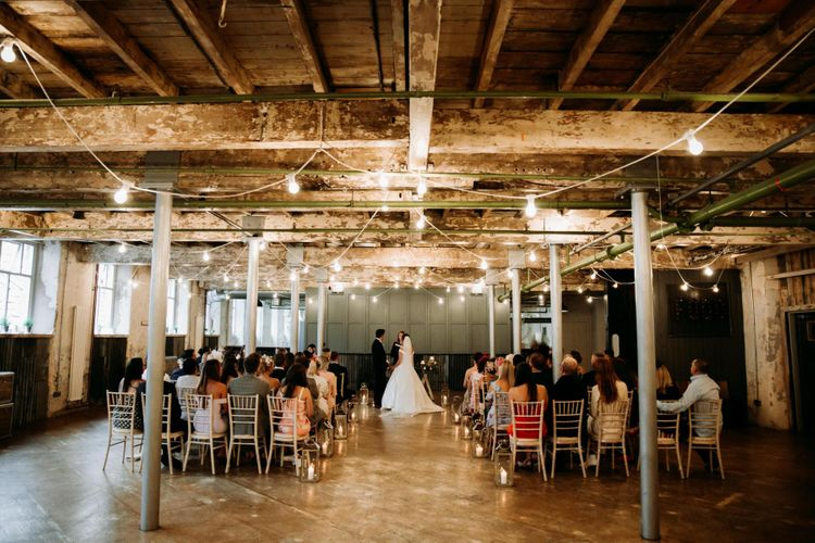 Stunning industrial wedding ceremony decor