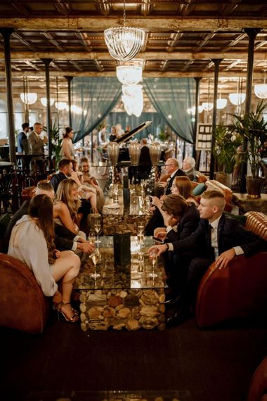 Guests enjoy wedding breakfast at Holmes Mill