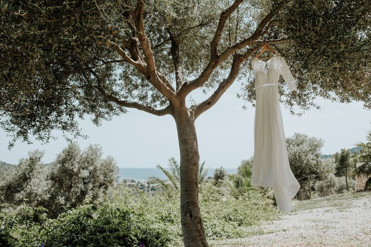 Lace Rembo Styling Wedding Dress Hanging From a Tree