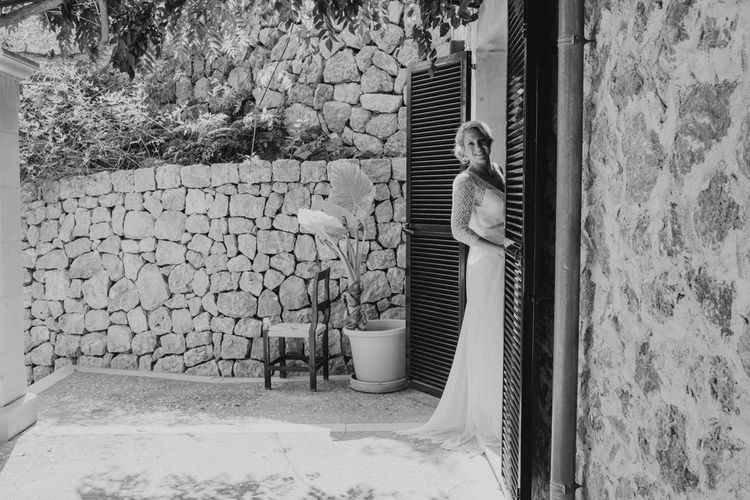 Bride Peeking Out the Venue in Lace Rembo Styling Wedding Dress