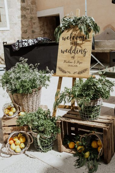 Wooden Wedding Welcome Sign with Crates & Baskets Decor