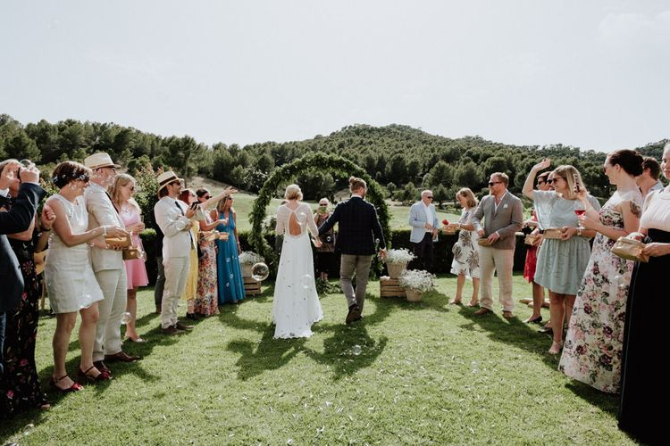 Confetti Moment with Bride in Rembo Styling Wedding Dress  and Groom  in Chino's and Checked Blazer