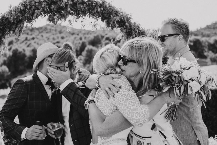 Bride and Grooms Hugging Their Wedding Guests