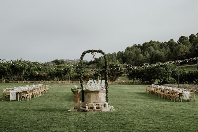 Sun Dial Wedding Feature with Foliage Arch and Candles