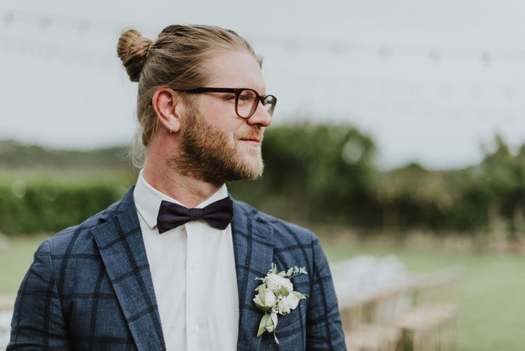 Stylish Groom in Navy Check Blazer, Bow Tie, Top Knot & Glasses