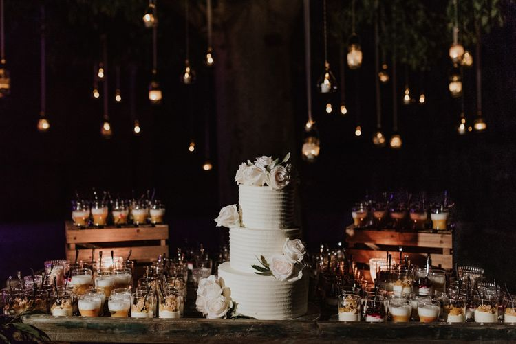 Dessert Table with White Wedding Cake and Individual Treats