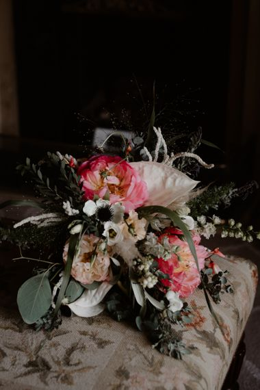 Wedding bouquet with coral peonies and foliage