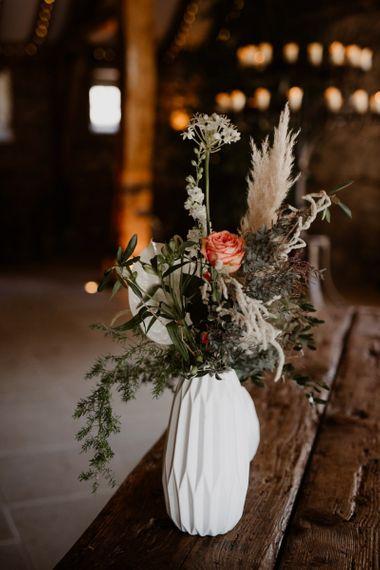 Wedding flowers in white vase