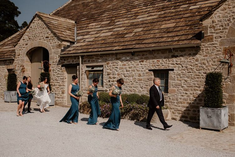 Bridesmaids walking to the Tithe Barn Bolton Abbey wedding ceremony