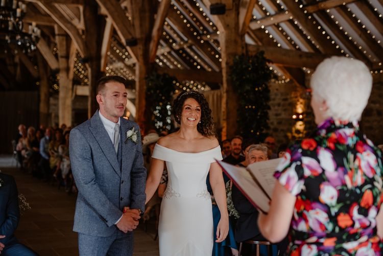 Bride and groom holding hands at Tithe Barn Bolton Abbey wedding ceremony