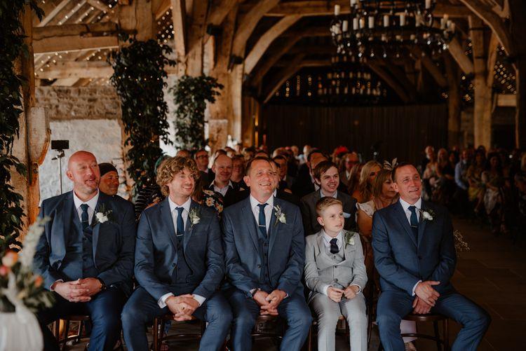 Groomsmen in blue wedding suits