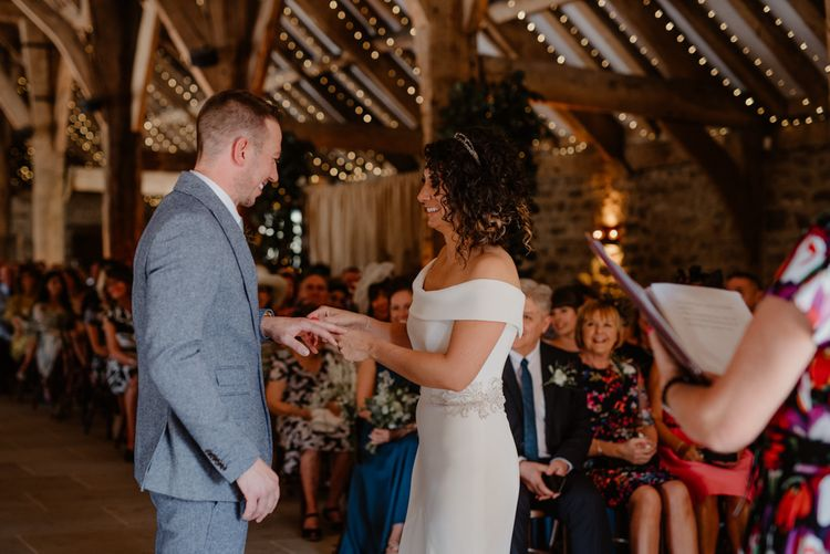Bride and groom exchanging rings at Tithe Barn Bolton Abbey wedding