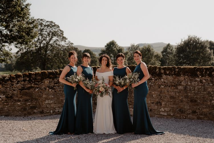 Bridal party portrait at Tithe Barn Bolton Abbey with bridesmaids in teal dresses