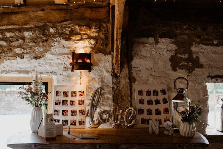 Wedding decor at Tithe Barn Bolton Abbey with foil balloon