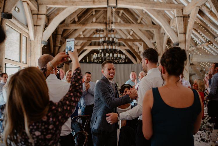Bride and groom entering the wedding reception