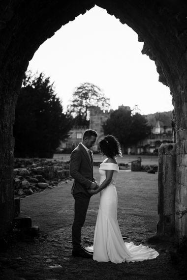 Black and white portrait of bride in Suzanne Neville wedding dress