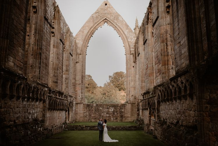 Bride and Groom portrait at Bolton Abbey Priory Ruins