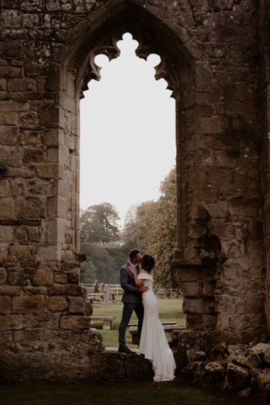 Bride and Groom portrait at Bolton Abbey Priory Ruins by Taylor-Hughes Photography