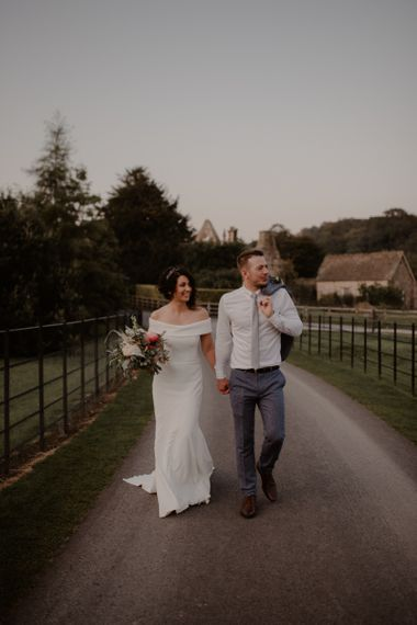 Bride and groom portrait on the grounds of Bride and Groom portrait at Tithe Barn, Bolton Abbey
