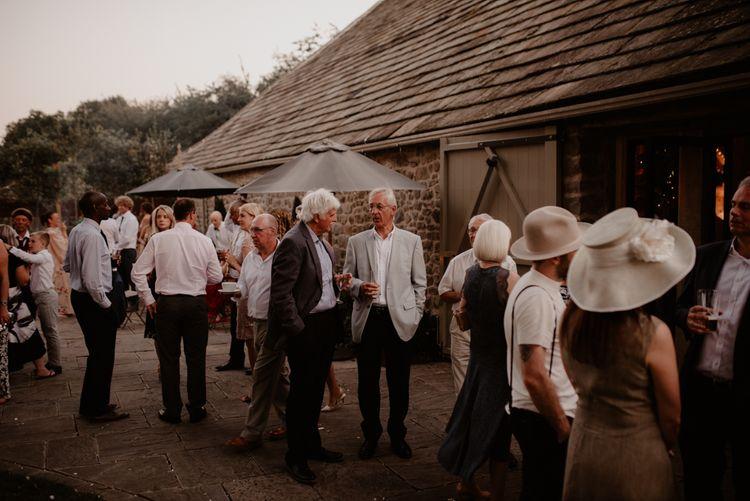 Wedding guests outside Tithe Barn, Bolton Abbey wedding venue