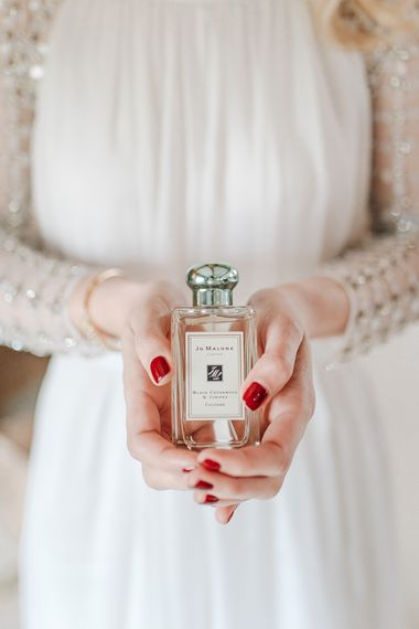 Bride with long sleeves and red nails - Jo Malone Wedding perfume