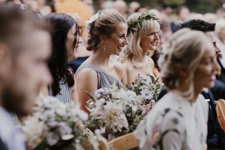 Bridesmaids In grey Dresses During Outdoor Ceremony
