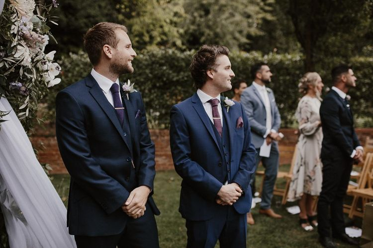 Groom and Groomsmen During Ceremony
