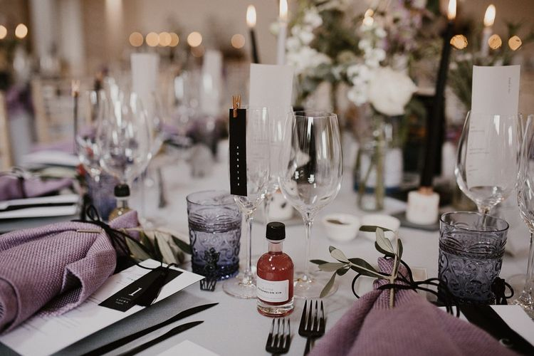 Wedding Table Setting Detail with Gin Wedding Favour and Foliage Details and Candles