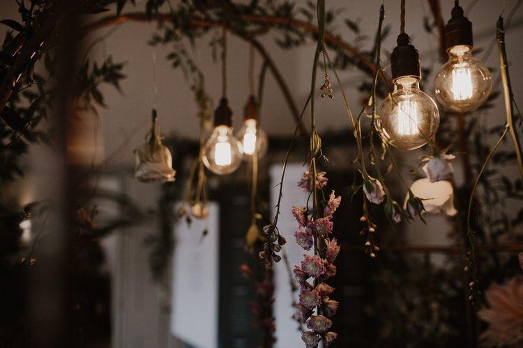 Drop Lighting With Flower Arrangements
