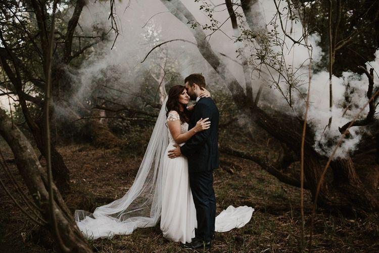 Smoke Bomb Wedding Portrait of Bride and Groom wearing Limor Rosen Wedding Dress