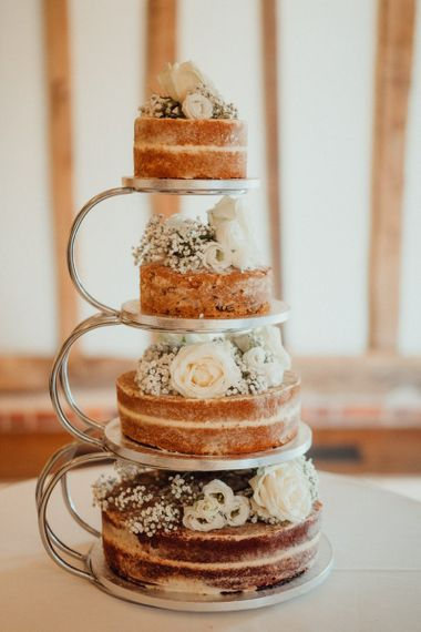 Naked wedding cake with flower decoration