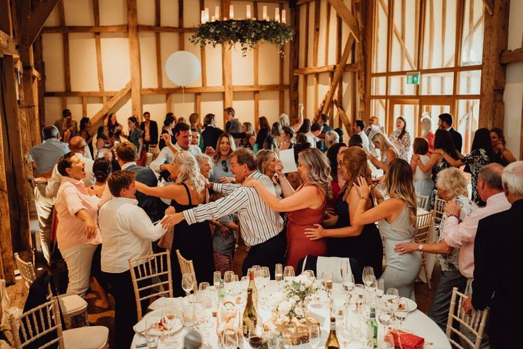 Guests enjoy entertainment at Micklefield Hall wedding venue