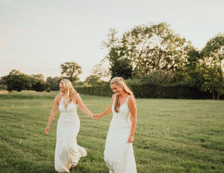 Same-sex wedding with both brides in lace wedding dresses