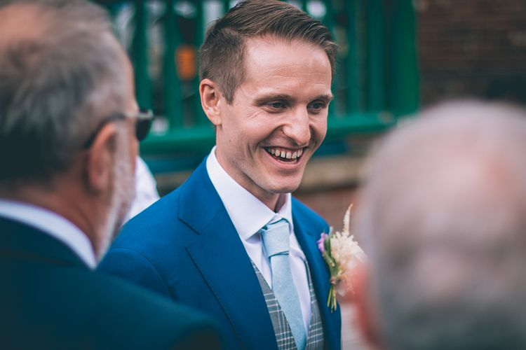 Groom in Royal Blue Suit with Pastel Blue Tie from Suit Supply | Halterneck Maggie Sottero Dress and Garden Games at Gate Street Barn | Story + Colour Photography
